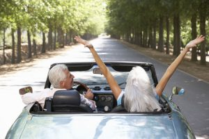 Retirees enjoying a nice drive in their own car